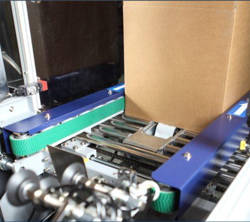 Formeuse de caisse carton automatique bande entrainement latérale