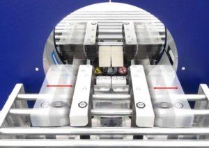 COMPACTA-PACKAGING-calage-sous-etirable avec entrainement latéral ajustable automatiquement